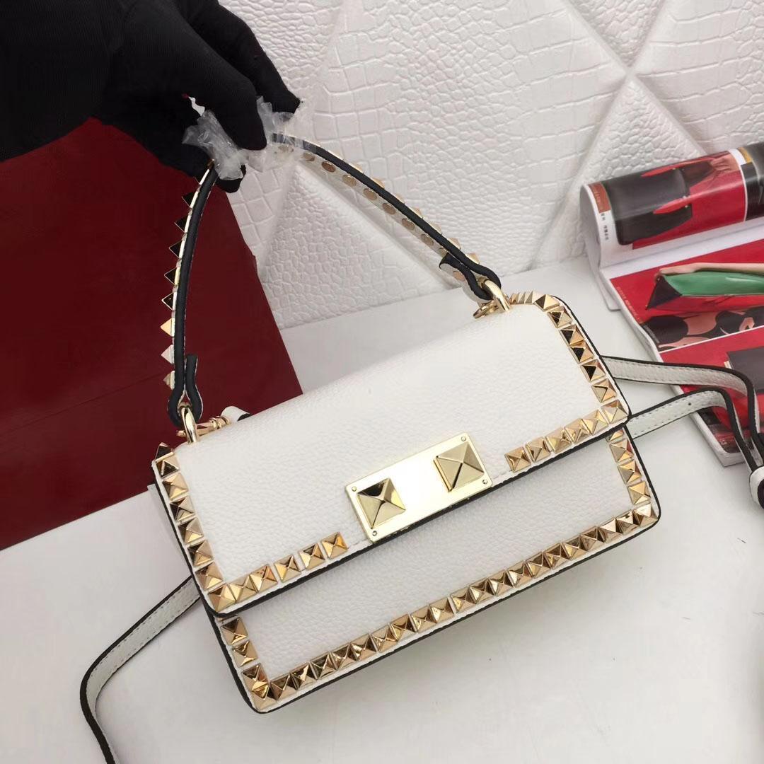Fashionable lady's handbag, designer handbag, diamond button, rivet and diamond ornament, leather material