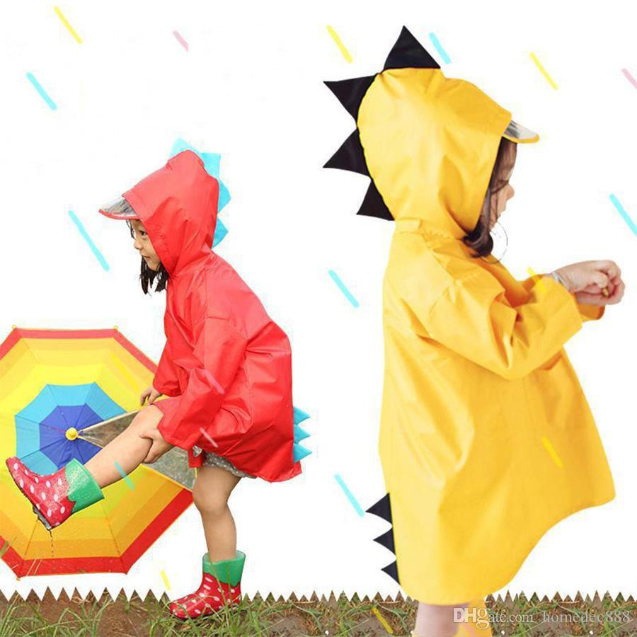 Chicos portátiles para niños a prueba de viento Poncho impermeable a prueba de agua niños lindos dinosaurio en forma de niños con capucha impermeable rojo impermeable DH0752