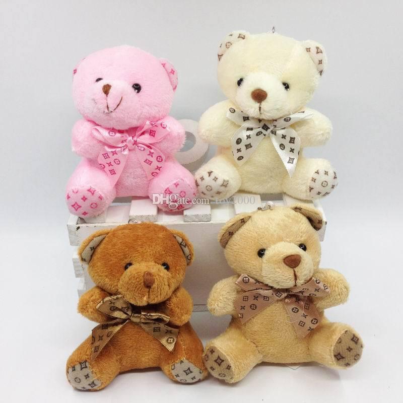 Oso de peluche con la bufanda muñecos de peluche muñeca clave anillo de regalo de las muchachas del bebé juguetes que lanzan y la decoración fiesta de cumpleaños