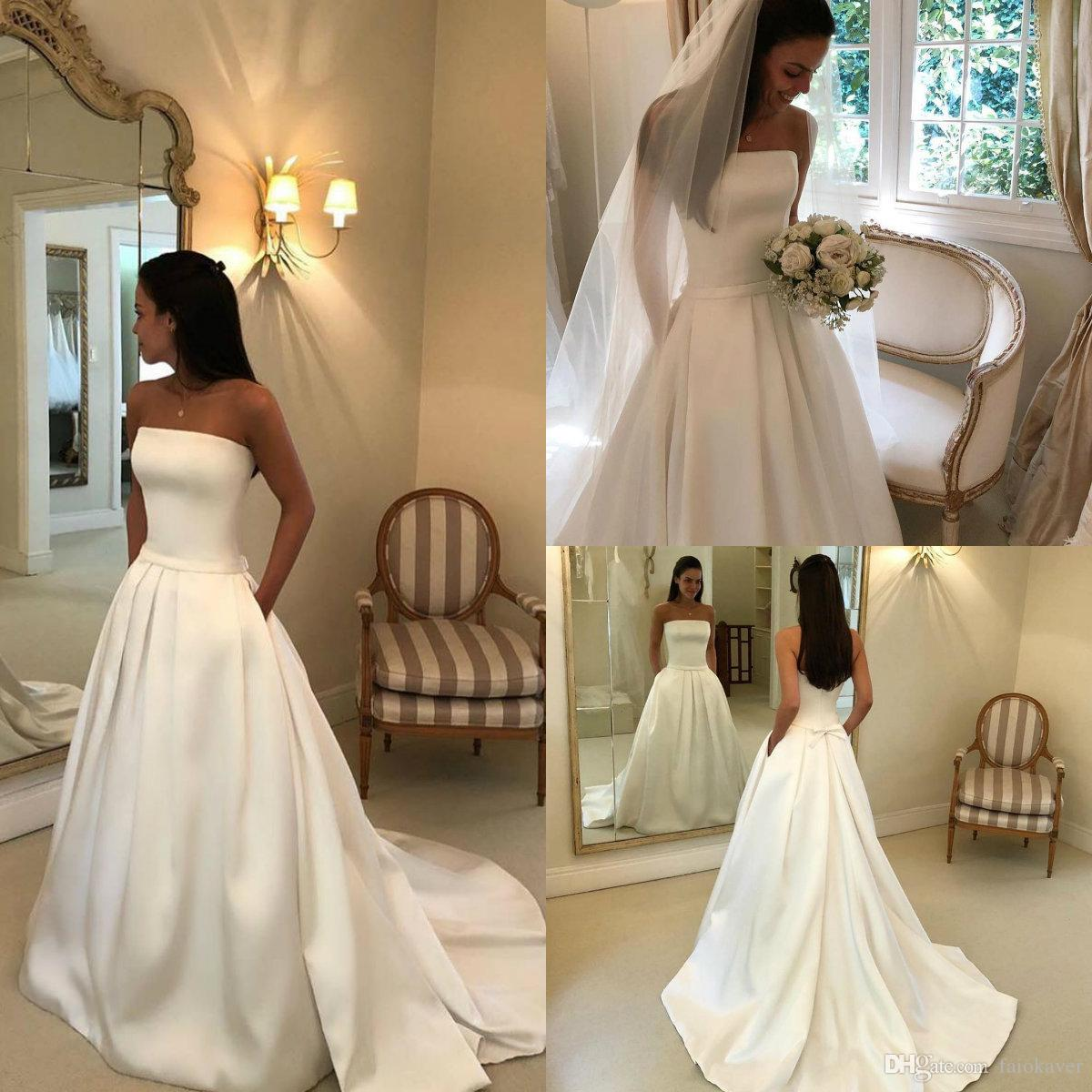 2019 Simple Satin Wedding Dresses With Pocket Strapless A Line Sweep Train Beach Wedding Dress Custom Made Cheap Bridal Gowns Garden Wear