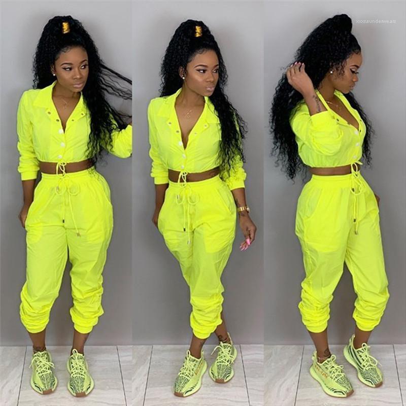 Ropa Casual mujeres del resorte 2pcs pantalones color sólido de los deportes fijados con el botón Mono Mujer