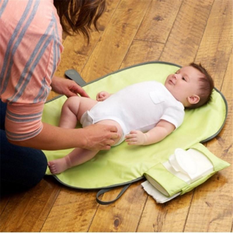 Baby-Windel Wickewasserdichte bewegliche Baby gewickelt Pad Reise-Station Clutch Babypflegeprodukte Hangs Stroller