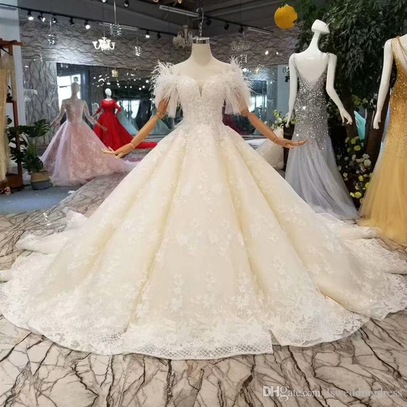 Ostrich Feather Wedding Gown Off The Shoulder Short Sleeve Ball Gown Hot Selling Lace Wedding Dress Actual Images Applique Bridal Gown