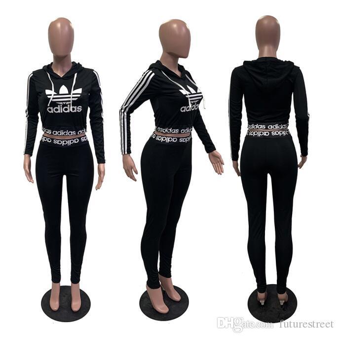 Deporte de las mujeres chándal Sudaderas Pantalones 2 piezas Conjunto de la mujer traje de ahueca hacia fuera Solid chándales para mujer de color sudaderas Ropa Ropa C129