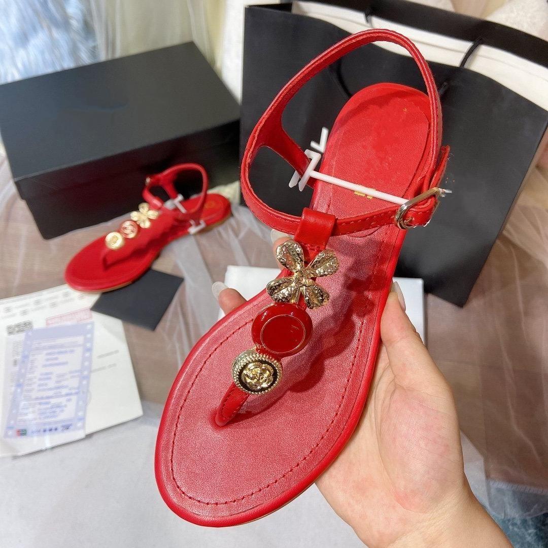 Markalı moda gerçek deri çiçek Flip 40'a pembe boyutu 35 düz sandaletler lüks kadın ayakkabı tasarımcısı beyaz bayan plaj ayakkabıları flop
