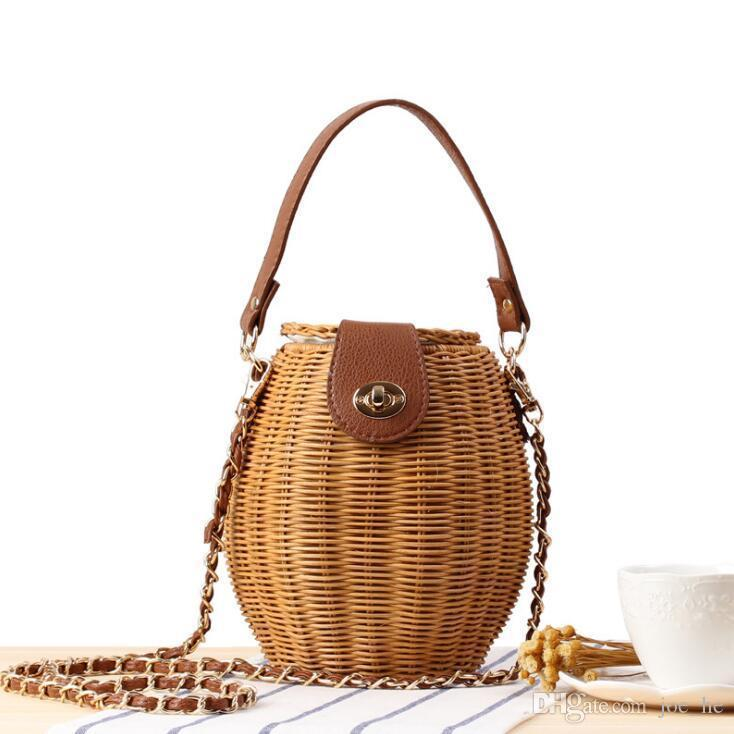 النساء بالجملة Designer- حقيبة يد الموضة المنسوجة حقيبة دلو جديدة اليابانية قفل الصغيرة سلة الأسماك حقيبة يد صغيرة جديدة الروطان المنسوجة حقيبة سلسلة