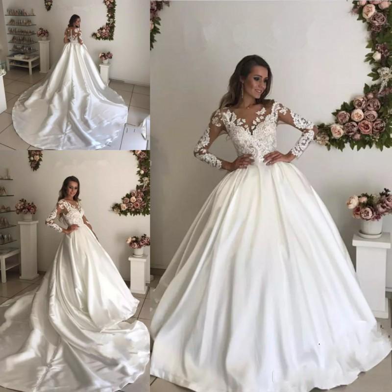 Más el tamaño de vestido de baile de vestidos de novia de encaje transparente de manga larga de cuello ilusión Volver vestidos de novia apliques tren capilla vestidos de novia