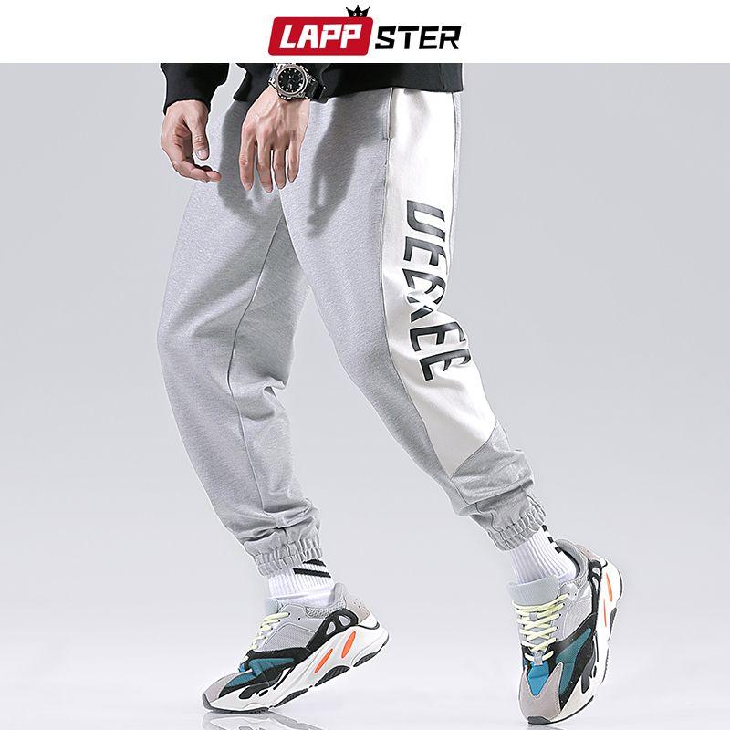 Pantaloni Uomo Streetwear Pantaloni 2019 Uomo di Hip Hop laterale a righe pantaloni della tuta Harajuku Casual Pantaloni sportivi pantaloni di modo