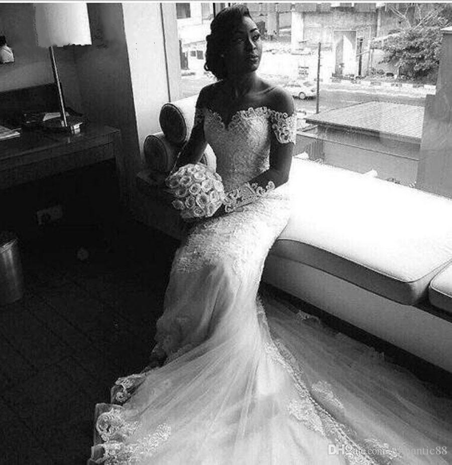 짧은 캡 슬리브 인어 트럼펫 웨딩 드레스 2019 아프리카 새로운 레이스 골동품 골치 아픈 건 버튼 플러스 사이즈 웨딩 드레스