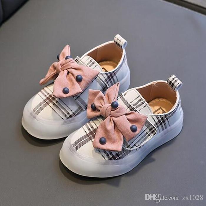 Neues Baby beschuht 2 Farben nette Plaid Prinzessin Bowknot Kid Shoes, die auf weichen ersten Wanderern rutschfest sind