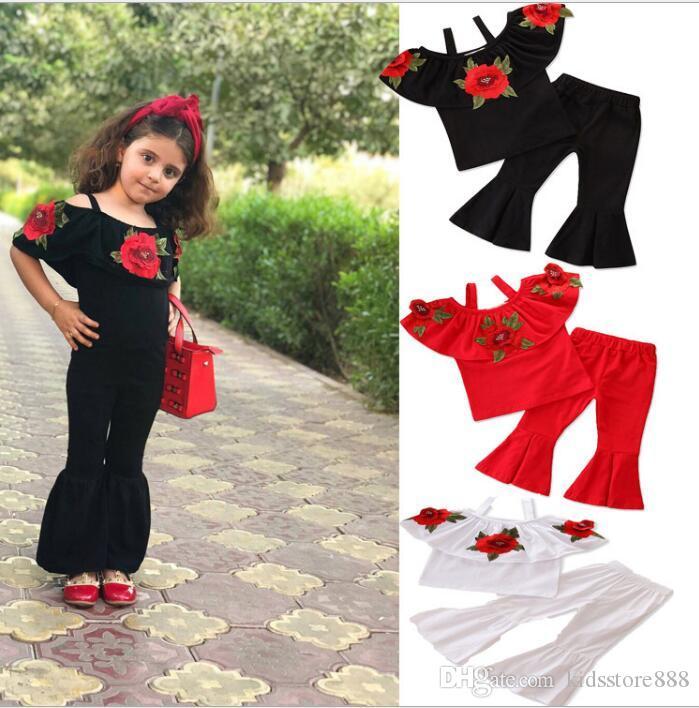 2 unids / set nuevo traje de la moda de los niños ropa de bebé niñas Rose top + pantalones acampanados ropa para niños niña conjunto ropa de niños