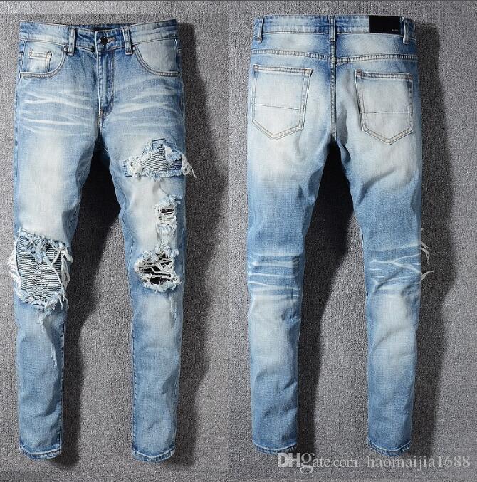 Buracos 20SS New dos homens azuis Buracos Jeans Men Motociclista Elegante populares Jeans Moda Motocicleta jeans calças calças