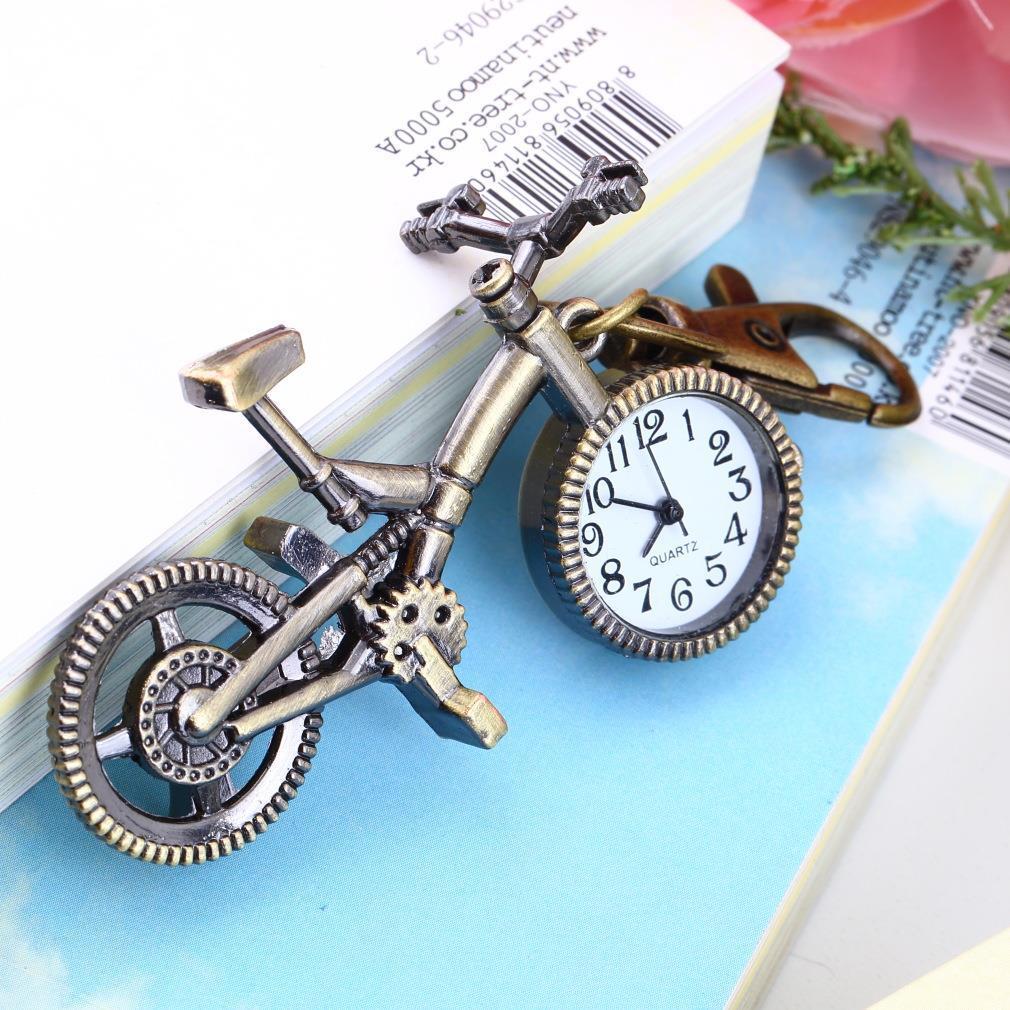 Arbeiten Sie Weinlese-Bronzen-Farben-Fahrrad-Schlüsselanhänger Uhr-Quarz-Taschen-hängenden Uhr-Halsketten-Strickjacke Schlüsselanhänger Taschen für Damen Jungen Geschenk