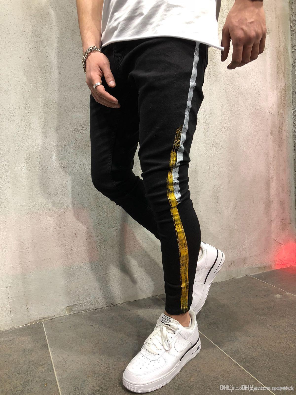 Jeans Uomo Abbigliamento nero Biker Side Stripes Homme Pantaloni designer di abbigliamento dei pantaloni della matita
