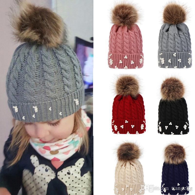 STUNNING WINTER WOOL CAP HAT WITH STUDS PEARLS AND POMPON.