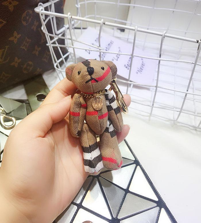 لطيف فو جلد الدب سلسلة المفاتيح لطيف الدب حلقة المفاتيح للمرأة على ظهره حقيبة حلية حلقة مفاتيح الدب هدية شيك جديد