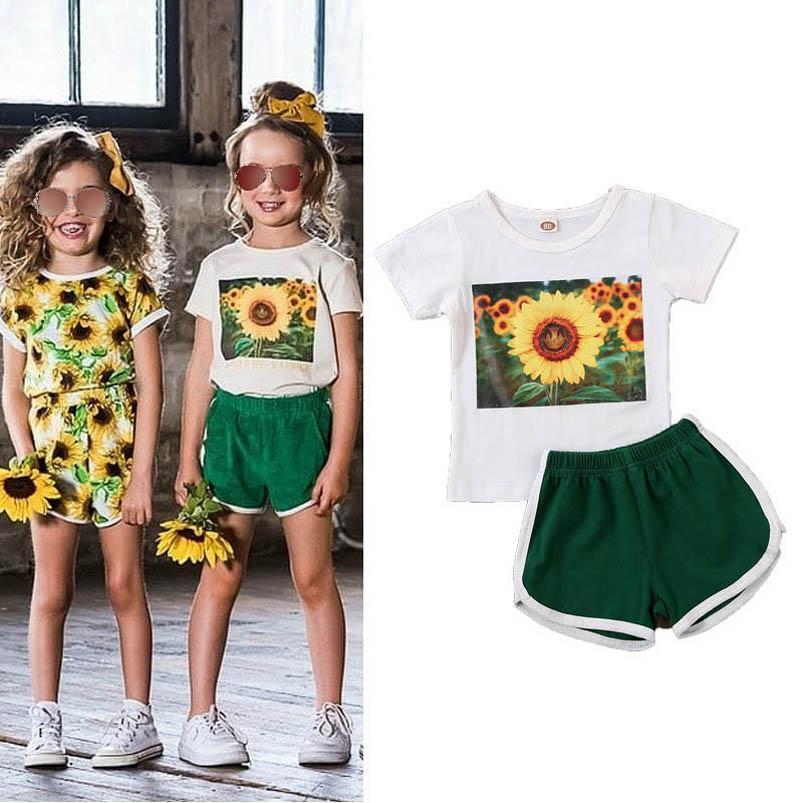 INS flor de las muchachas del verano ocasionales adapte a los niños muchachas de los juegos chándal chándal niños niños niñas ropa de diseño de la camiseta + shorts 2pcs / B1608 conjunto