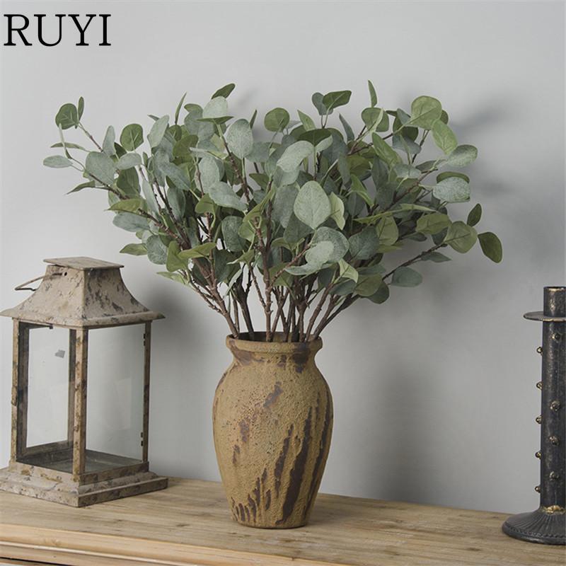 L'eucalyptus artificiale lascia la decorazione di nozze della foglia dei soldi dell'oro del fiore di simulazione di stile europeo per la decorazione domestica del partito dell'hotel 1pcs