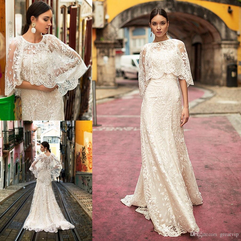 Oksana Mukha 2019 Robes de Mariée avec Wraps spaghetti dentelle Applique balayage train Robes de mariée plage robe de mariée