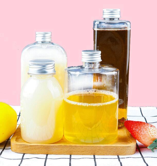 Plastique bouteille de boissons 250-550ml bouteilles de jus ronde transparent Bouteilles plat carré de fuite d'eau à l'épreuve boisson Coupe avec couvercle 200pcs GGA3486