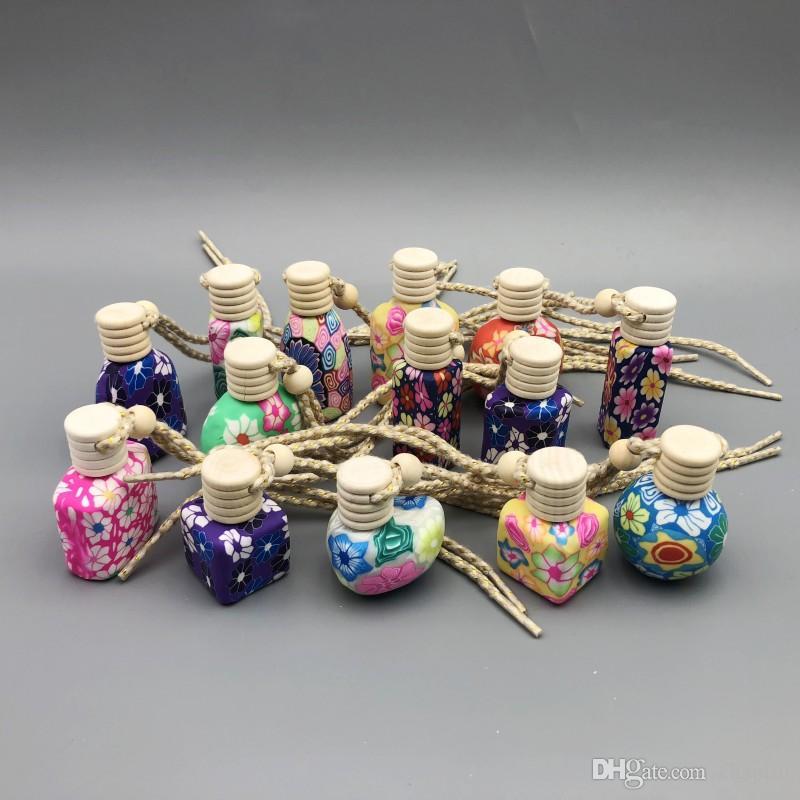سيارة 10-15 مل معلقة حبل فارغ وزجاجة زينة اليد جعلت من البوليمر كلاي خزفي زجاجة عطر زيتية أساسية مع غطاء خشبي