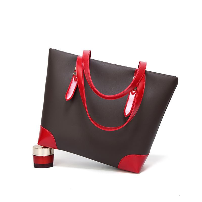 The Direct and Lady's Europe New Simple Back besorgt Moderne Großhandel Vereinte Sale Sale Splice Fabrik Handheld Einzelner Schulter JKLHI