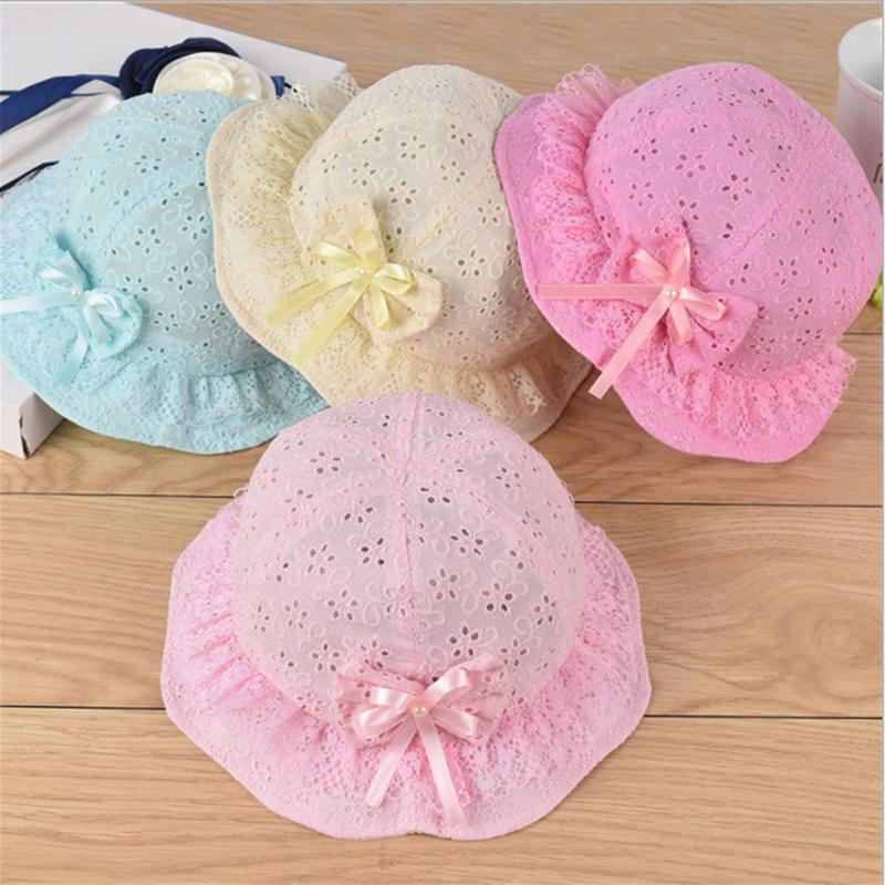 Neonate Fisherman cappello delle ragazze dei capretti del cappello dell'arco Pearl nodo di modo del bambino della benna Sun floreale estate dei bambini Cappelli Panama Hollow