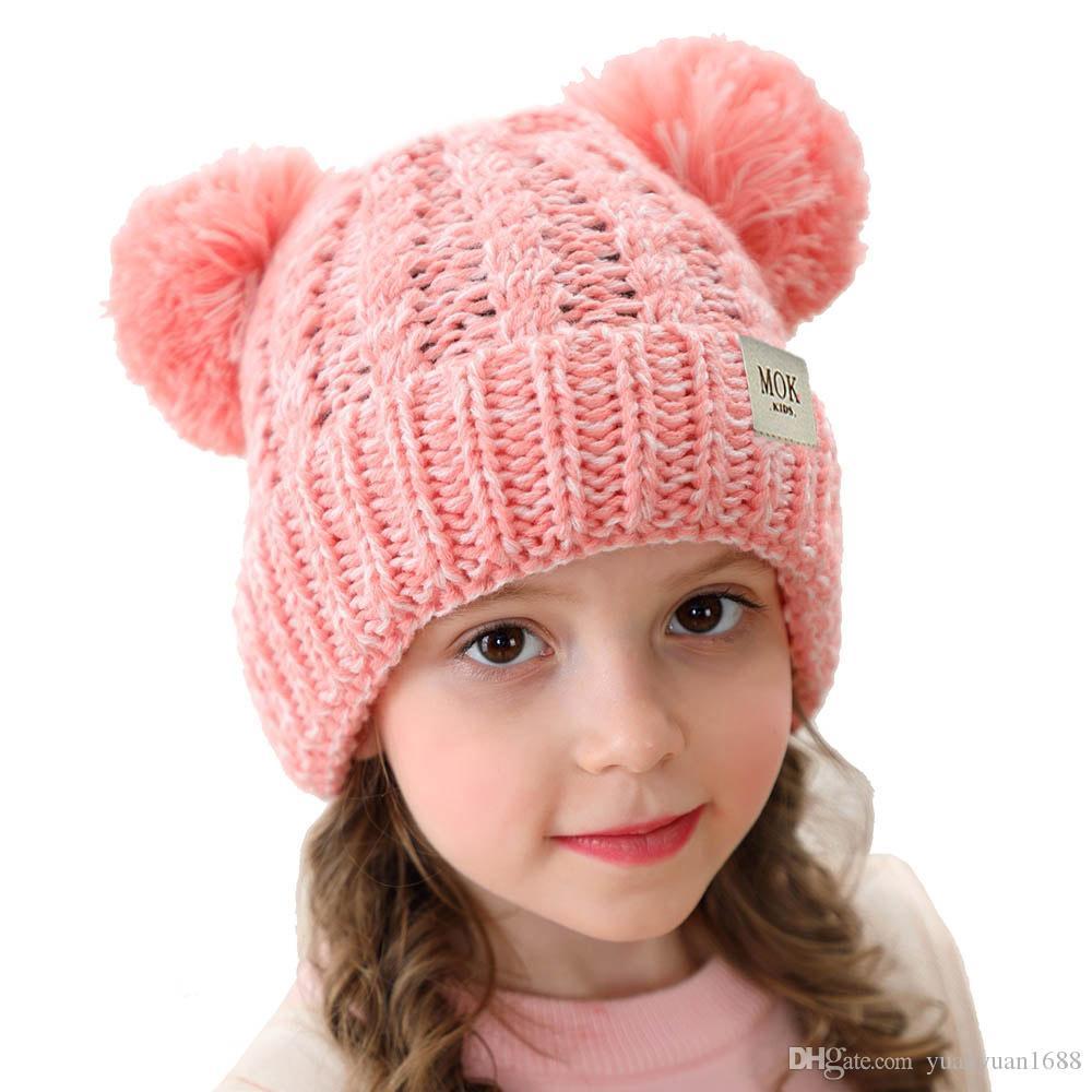 Çocuk şapka yün örme şapka 2019 sonbahar ve kış yeni büküm dokunmuş çift bilyalı saç top şapka erkekler ve kızlar Cap