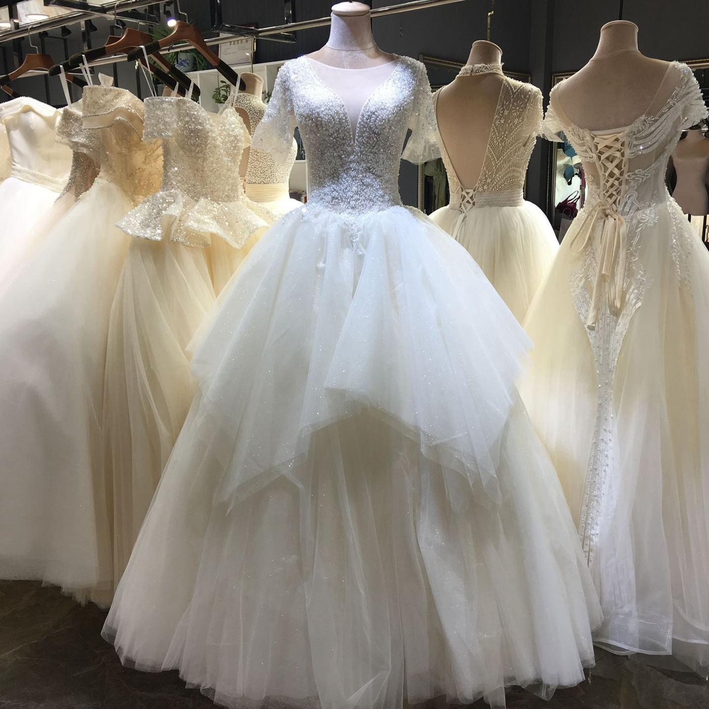 Nueva llegada de tul de novia vestidos de champán con medias mangas una línea de vestidos de novia detrás rebordeado abierto vestidos de boda Vestidos de novia