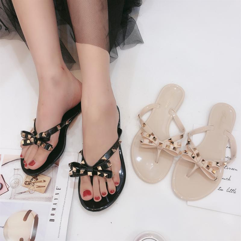 El nuevo verano de la nueva Liu Ding Xiaoxiang nudo de la mariposa de cristal jalea zapatillas espiga pizca sandalias femeninas