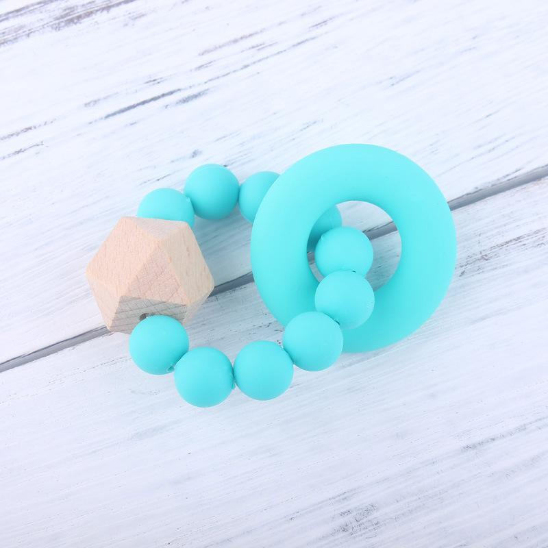 Baby-Silikon-Korn Zwei Ringe Baby Health Care Zubehör Säugling Finger Exercise Spielzeug buntes Silikon-wulstige Beruhigungssauger