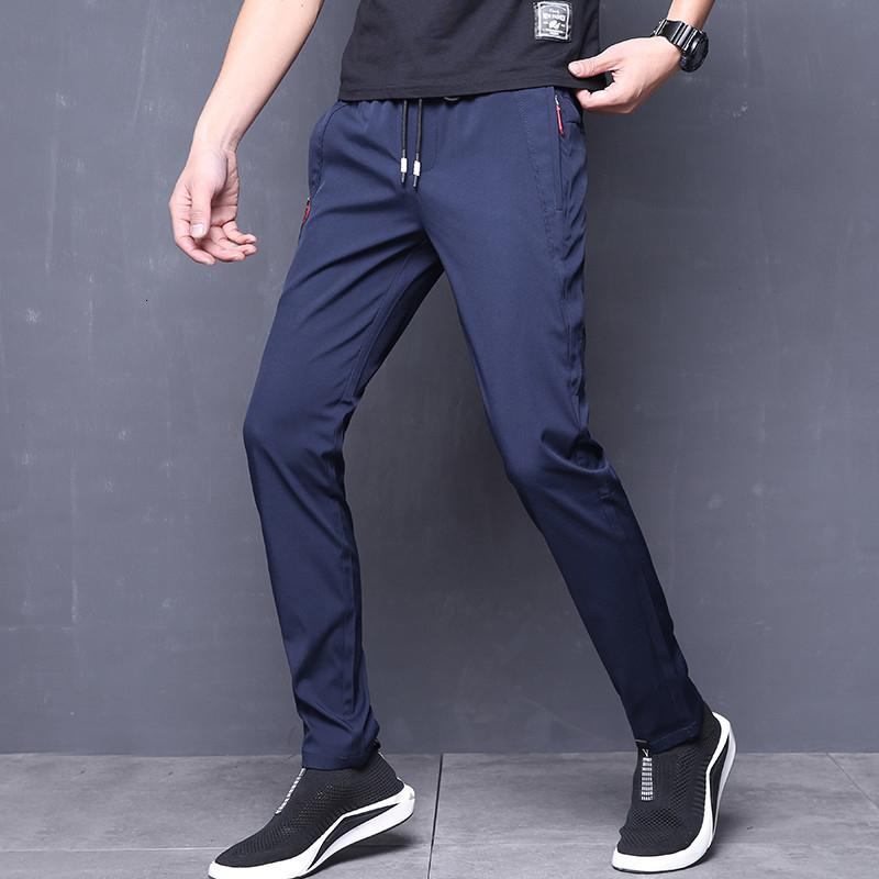 Compre Pantalones De Verano Para Hombre Skinny Stretch Pantalones Casuales Coreanos Slim Fit Chino Cintura Elastica Jogger Pantalones De Vestir Hombre Negro Azul Sh190915 A 10 08 Del Tai01 Dhgate Com