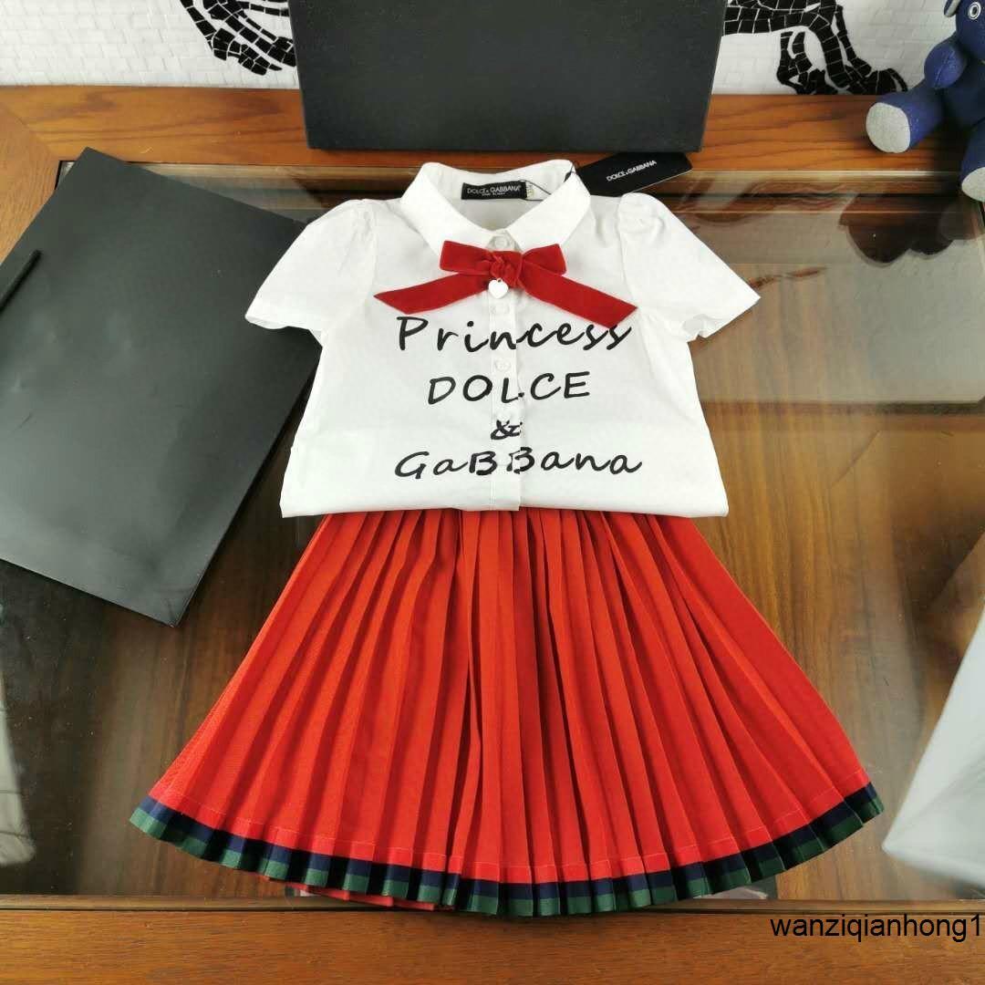 Весна и лето последние девушки немного свежий школьный стиль рубашка + плиссированная половина юбки две части юбки 032811