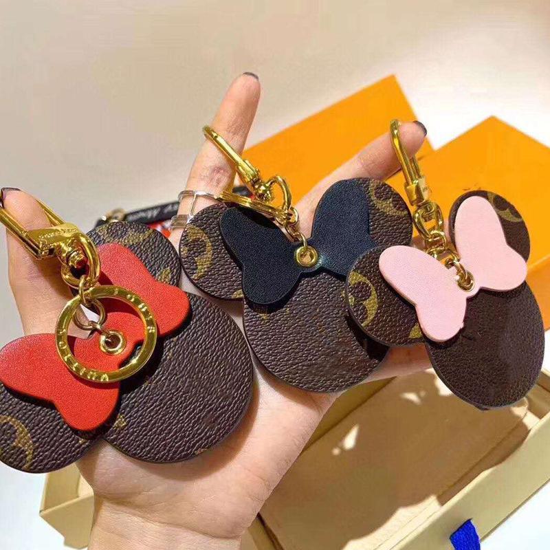 Designer de luxo de couro Keychain animal Design Arco Pingente encanto do saco para Girl Fashion bonito Titular rato Chaveiro Mulheres Chaveiro Anel Jóias