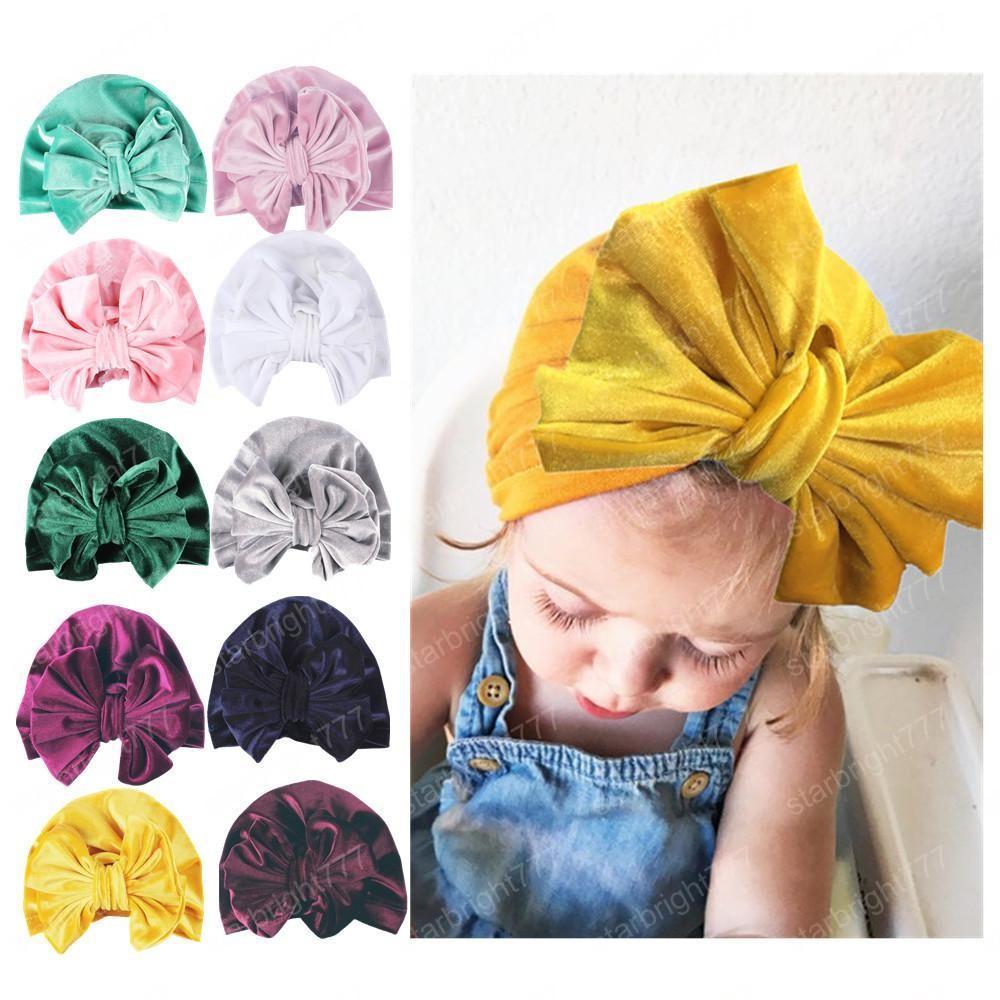 Nueva Europa para bebé bebés del sombrero del Bowknot, gorros niño del niño para niños Gorros Turban niños de los sombreros de Pleuche sombreros 12 colores