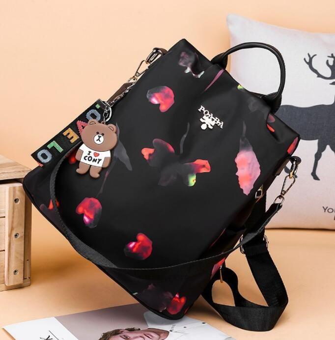 Livre post simples moda feminina mochila bolsa de ombro selvagem moda menina cute campus pacote de tendência