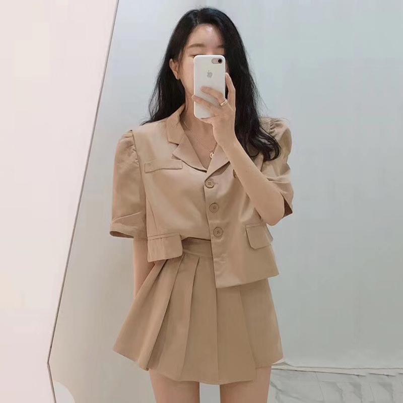 Deux pièces Set Top and Jupe Été Femmes Blouse à manches courtes à manches courtes et à la taille haute Mini jupe plissée sexy