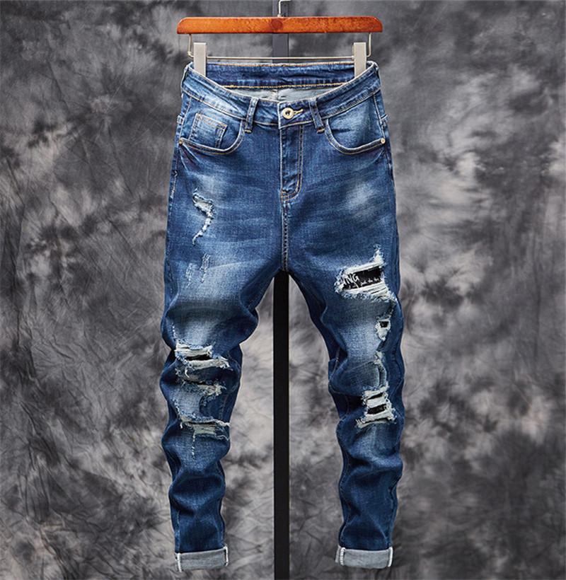 Tasarımcı Moda Erkek Jeans Birçok Delik Tasarım Dekorasyon Kazıma Mens Kalem Pantolon Düğme Pileli Lüks Jeans