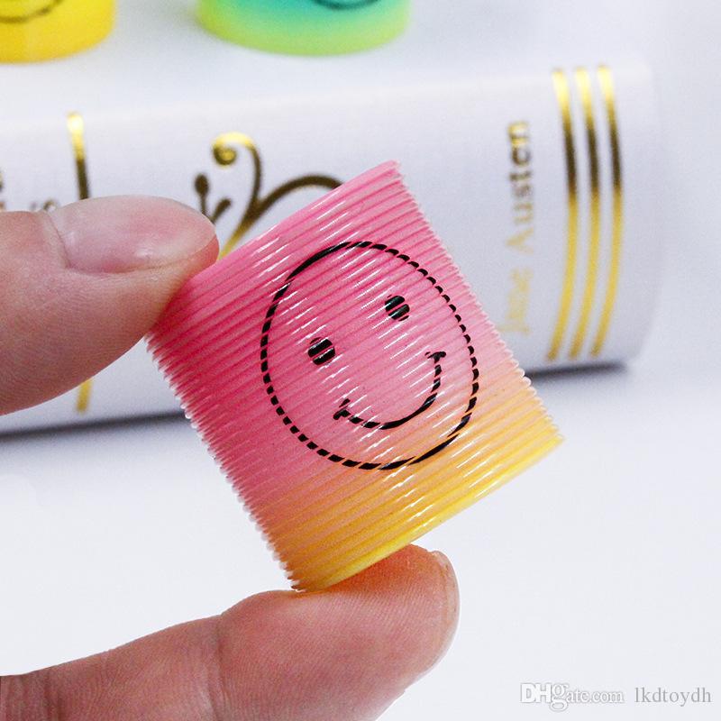 Antiestrés magia de plástico Sonrisa del arco iris de colores de primavera Círculo de bobina anillo elástico juguetes educativos para niños Juegos