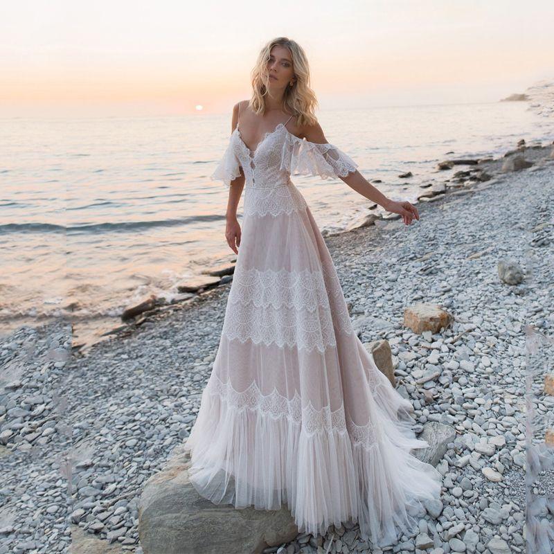 Bohemian Vestidos de casamento 2020 Vestido de Noiva Off Shoulder Lace apliques vestidos de noiva Sexy Backless Praia A linha Robe De Mariee T200525