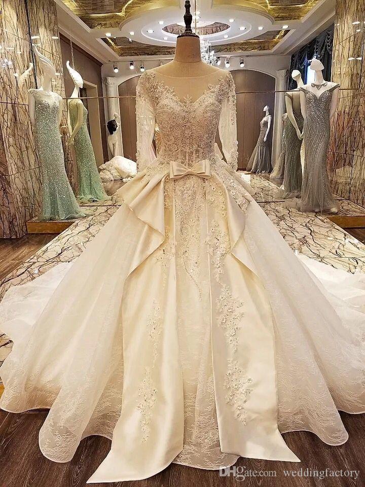 2019 Recién llegado de lujo Vestidos de boda Sheer Bateau Cuello en V Parte posterior con cordones Perlas Cuentas Apliques Vestidos de novia con mangas transparentes