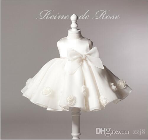 عيد ميلاد الحزب توتو فساتين لطفلة الحرير الأبيض القوس الكبير تصميم زفاف التعميد الوليد طفل الفتيات بوتيك الملابس