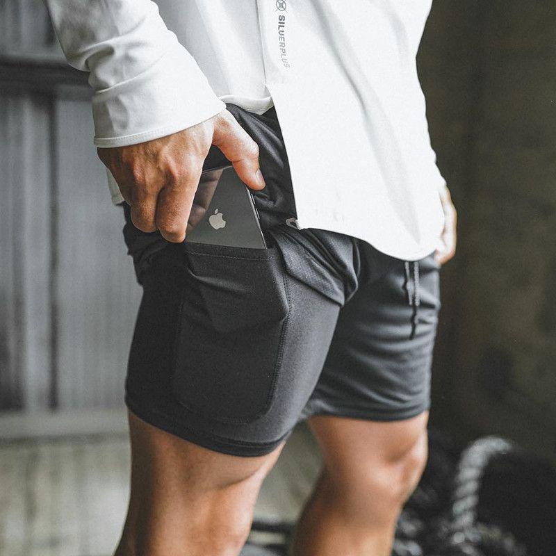 2019 Nuevos hombres Deportes Gimnasio Teléfono de compresión Bolsillo debajo de la capa base Pantalones cortos Atlético Sólido Medias Pantalones cortos Pantalones