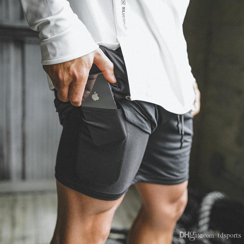2019 Nuevos hombres Deportes Gimnasio Teléfono de compresión Desgaste de la bolsa bajo la capa base Pantalones cortos Atlético Medias sólidas Pantalones cortos Pantalones