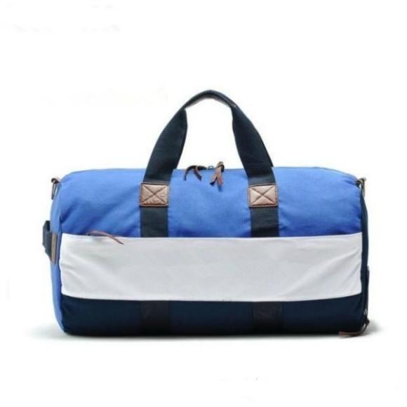 Nouvelle mode Qualité marque Sac Voyage nouveau couple Sacs de voyage Bagages à main pour les hommes et les femmes Duffle Bag 55CM