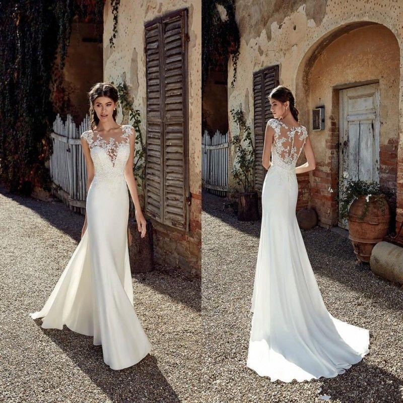 2019 New Designer Beach Wedding Dresses Sexy Lace Applique Sheer Neck Floor Length Bohemian Cheap Wedding Dress Bridal Gowns