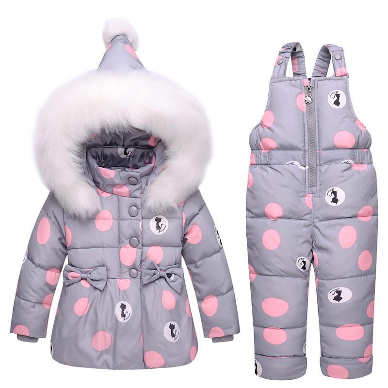Neue Säuglingsbaby-Wintermantel Snowsuit Duck Down-Kleinkind-Mädchen-Winter-Outfits Schnee tragen Jumpsuit bowknot Tupfen-Jacken