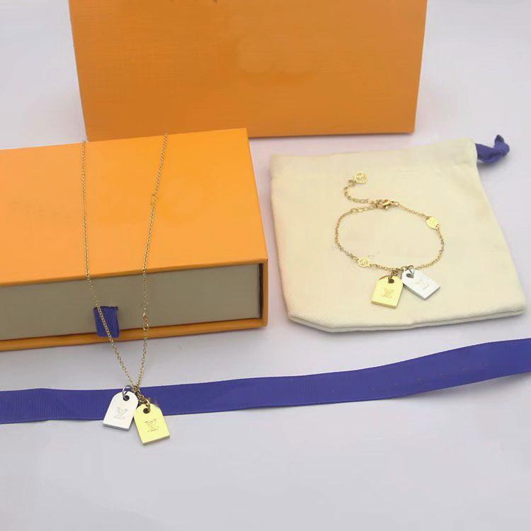 جديد وصول موضة مجموعات مجوهرات سيدة نساء التيتانيوم الصلب 18K الذهب قلادة سلسلة سوار مع V رسالة مزدوجة اللون السلس الكلمات سحر