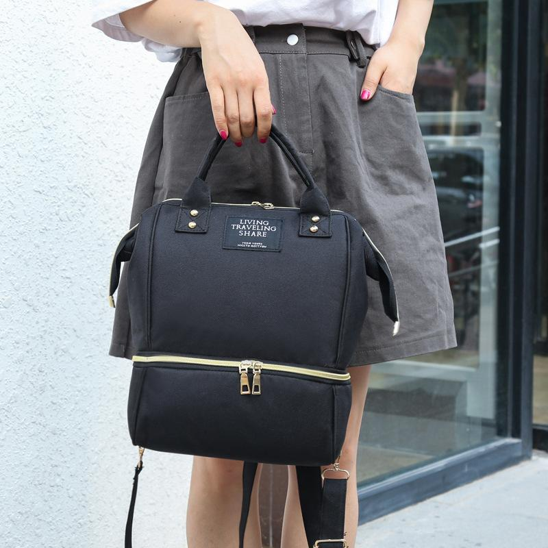 La nuova borsa coreana mummia sacchetto impermeabile femminile borsa a tracolla di colore solido grande capacità bagnato e la separazione secco di madre e
