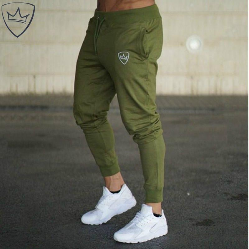Os homens novos Corredores Marca Masculino Calças Calça Casual Sweatpants Jogger Grey Casual Calças de treino Elastic Cotton academias de fitness